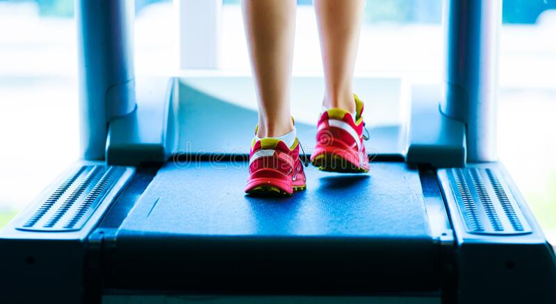 Digital composite of Highlighted foot bones of jogging woman. In mordern gym stock photo
