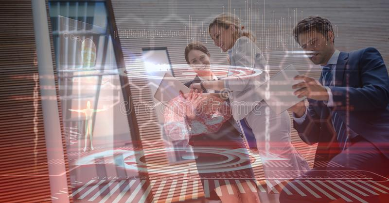 Digital composite image of business people using technologies stock images