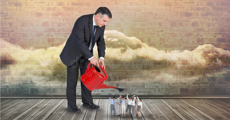 Digital composite image of businessman pouring water on employees from watering can royalty free illustration