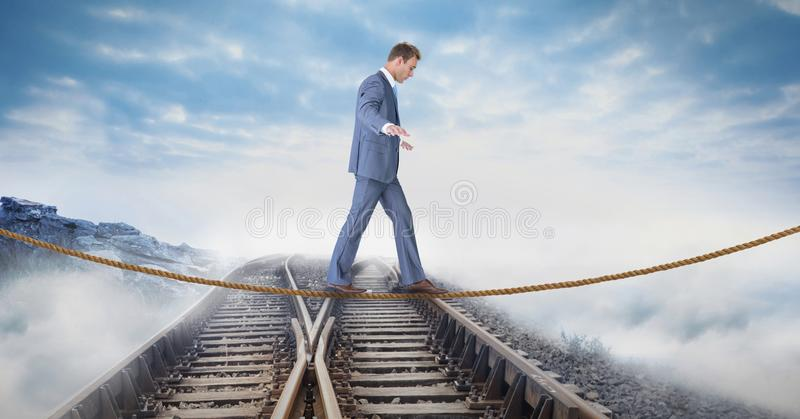 Digital composite image of businessman walking on rope over railway tracks. Digital composite of Digital composite image of businessman walking on rope over stock illustration