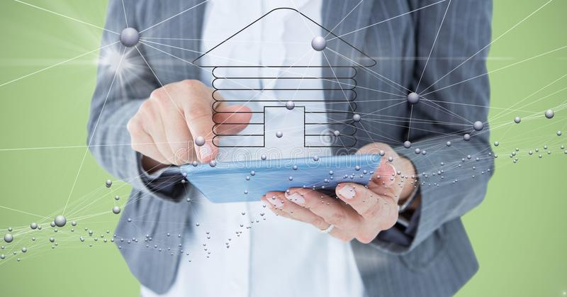 Digital composite image of businesswoman holding tablet computer with home symbol and connecting dot. Digital composite of Digital composite image of stock illustration