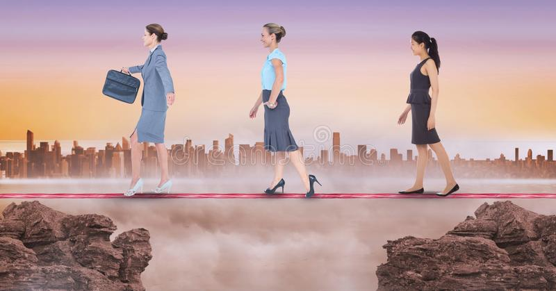 Digital composite image of businesswomen walking on rope during sunset. Digital composite of Digital composite image of businesswomen walking on rope during stock illustration