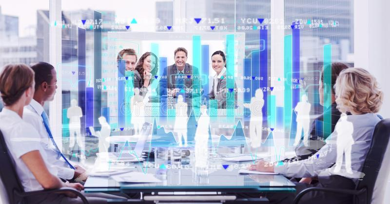 Digital composite image of employees and tech graphics against business people in conference room. Digital composite of Digital composite image of employees and stock photo