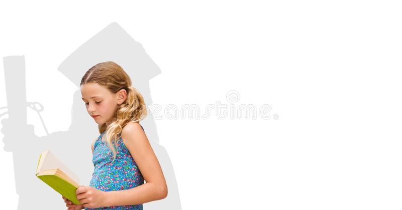 Digital composite image of girl reading book with graduate shadow in back royalty free stock photography