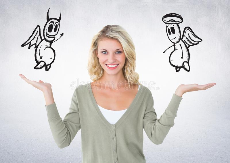 Digital composite image of smiling woman with angel and devil on her hand stock photography