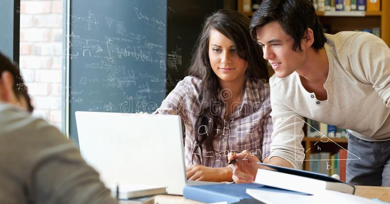 Digital composite image of students discussing math equation royalty free stock photo