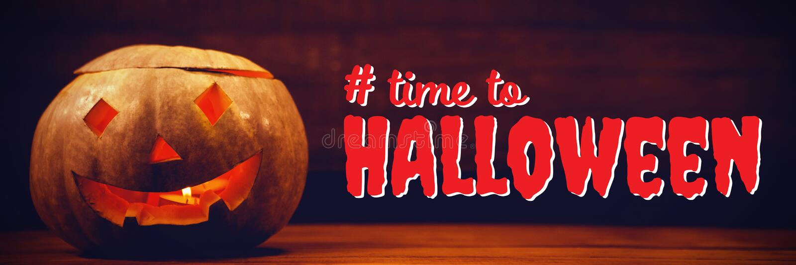 Composite image of digital composite image of time to halloween text. Digital composite image of time to Halloween text against illuminated jack o lantern on stock images