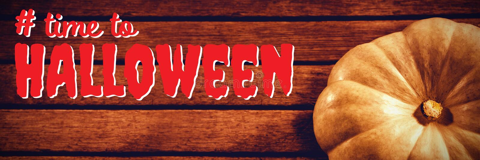 Composite image of digital composite image of time to halloween text. Digital composite image of time to Halloween text against white pumpkin on wooden table royalty free stock image
