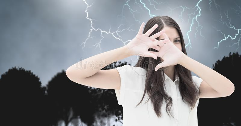 Lightning strikes and scared afraid woman. Digital composite of Lightning strikes and scared afraid woman royalty free stock photo