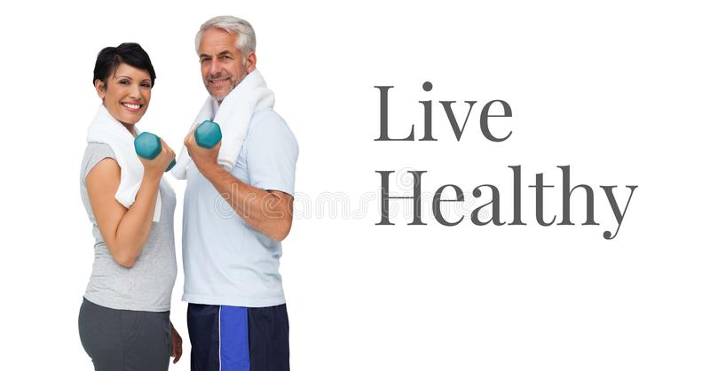 Live healthy text and fitness couple lifting weights. Digital composite of Live healthy text and fitness couple lifting weights stock photo