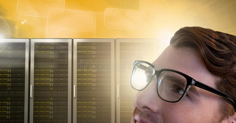 Man with computer servers and glasses royalty free stock photography
