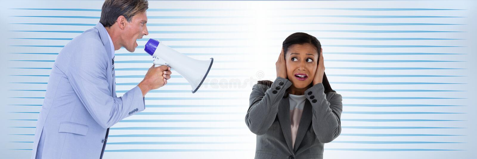Man with megaphone screaming at woman stock image