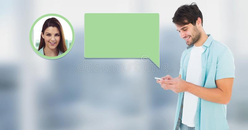 Man using phone with chat bubble messaging profile stock image