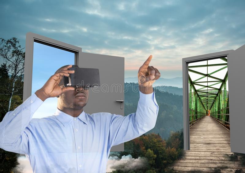 man with VR glasses in the forest with two doors to go other place royalty free stock photos