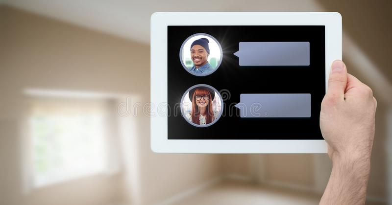 Messaging App on tablet in hand with chat profiles stock images