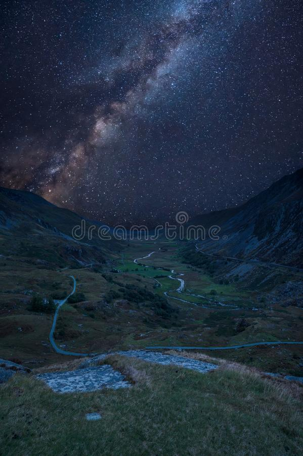 Digital composite Milky Way image of Beautiful dramatic landscape image of Nant Francon valley in Snowdonia royalty free stock image