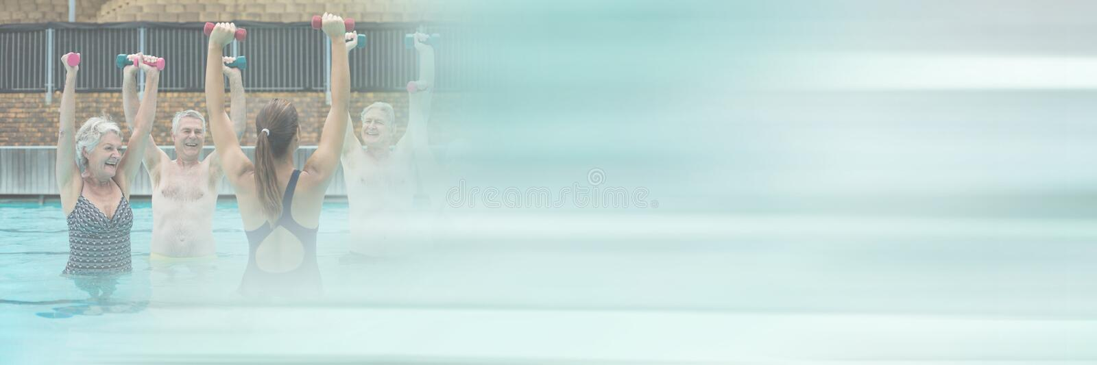 Old people exercising in Swimming pool with transition royalty free stock photography