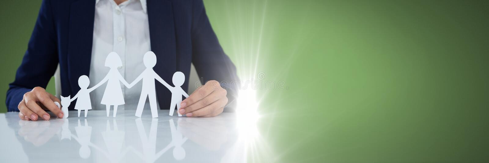 Paper Cut Out family in hands stock image