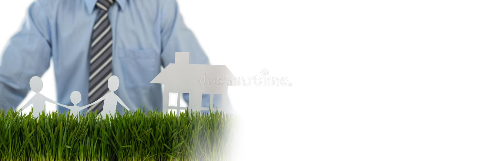 Paper Cut Out family home with businessman. Digital composite of Paper Cut Out family home with businessman stock image