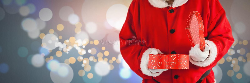 Santa holding gift. Digital composite of Santa holding gift stock images
