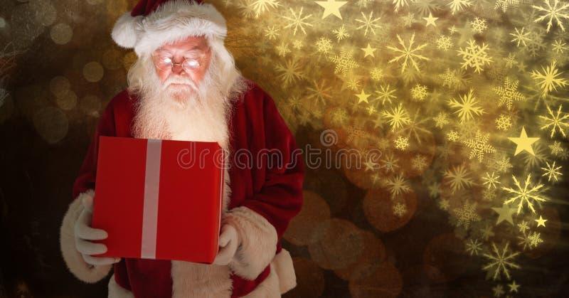 Santa holding gift and Snowflake Christmas pattern. Digital composite of Santa holding gift and Snowflake Christmas pattern royalty free stock images