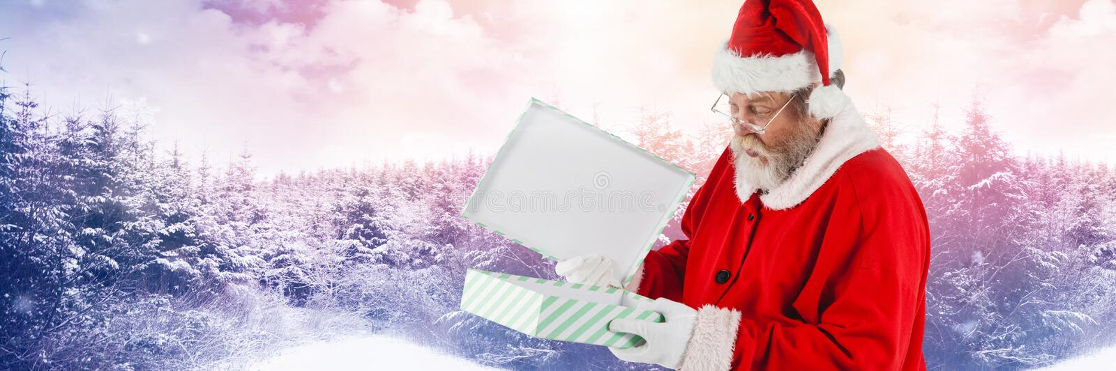 Santa with Winter landscape and gift. Digital composite of Santa with Winter landscape and gift stock photography