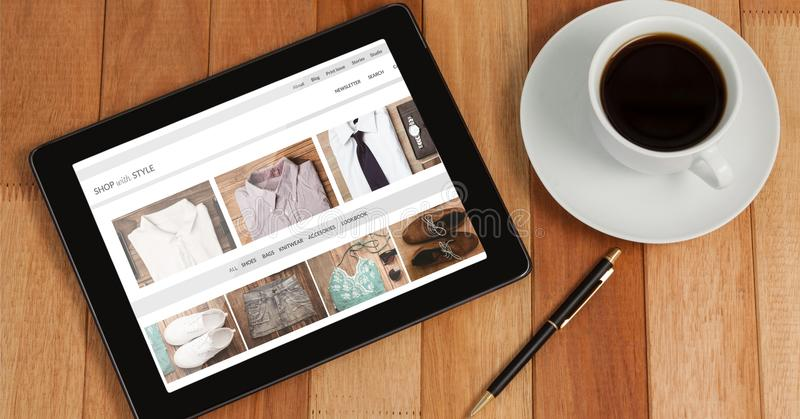 Tablet with online clothes shop mock up royalty free stock images