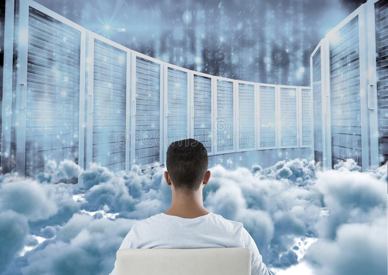Teenager sitting looking at simulation through clouds royalty free stock photos