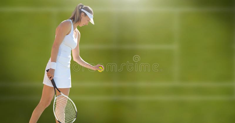 Tennis player woman with green background with racket royalty free stock image