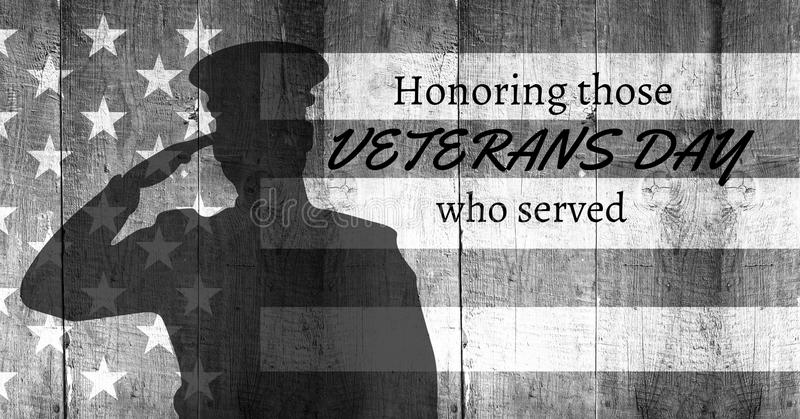 veterans day soldier in front of flag stock photo