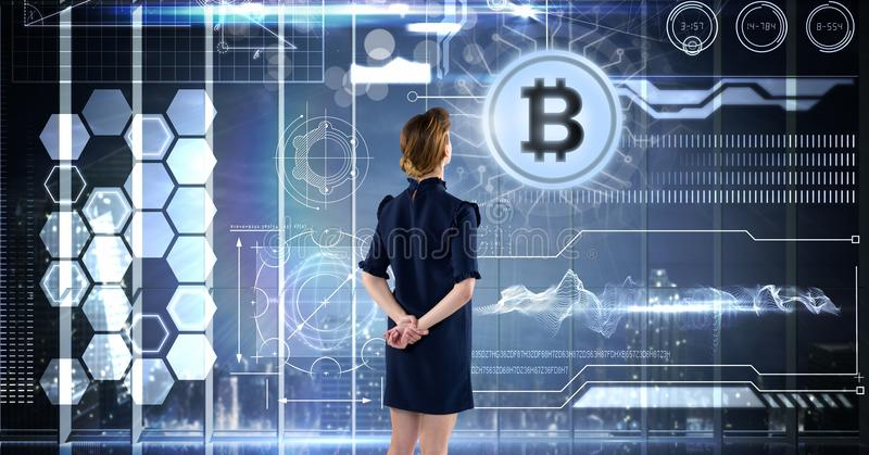 Woman with bitcoin technology information interface royalty free stock photo