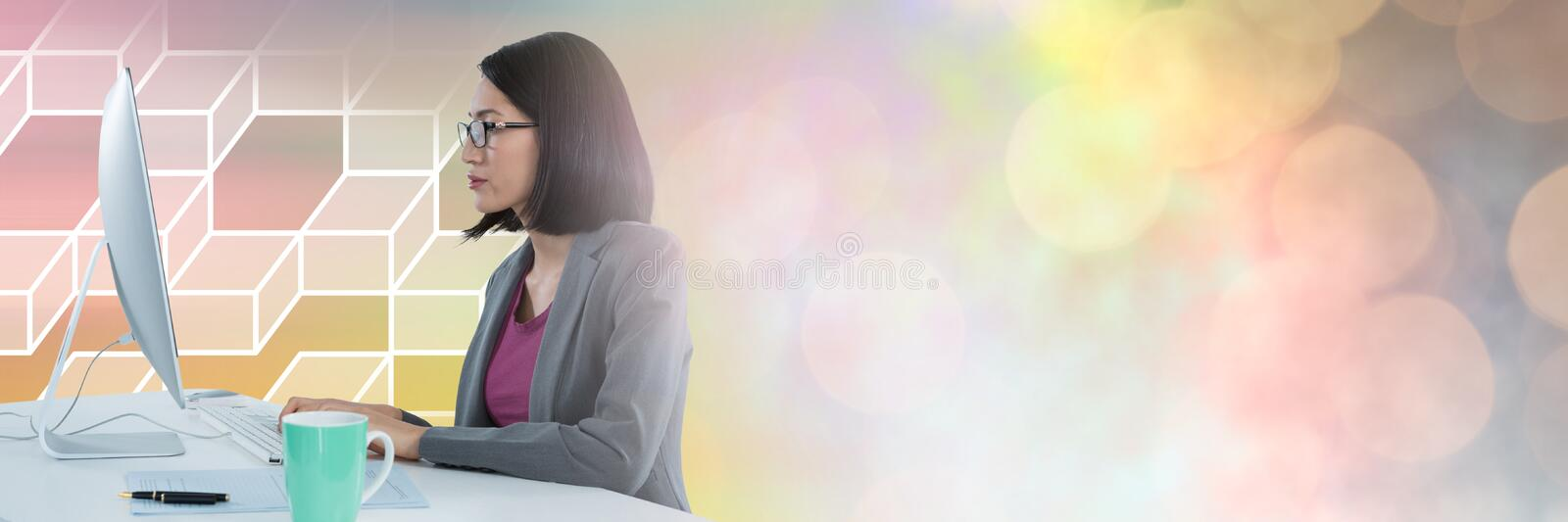 Woman using computer with geometric transitions royalty free stock photography