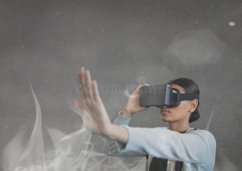 Woman with vr headset feeling projection. Digital composite of woman with vr headset feeling projection royalty free stock image