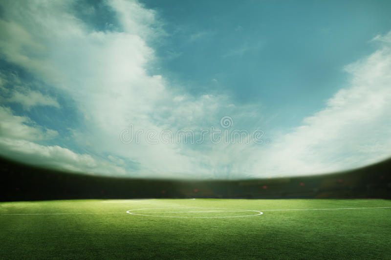 Digital coposit of soccer field and blue sky royalty free stock photography