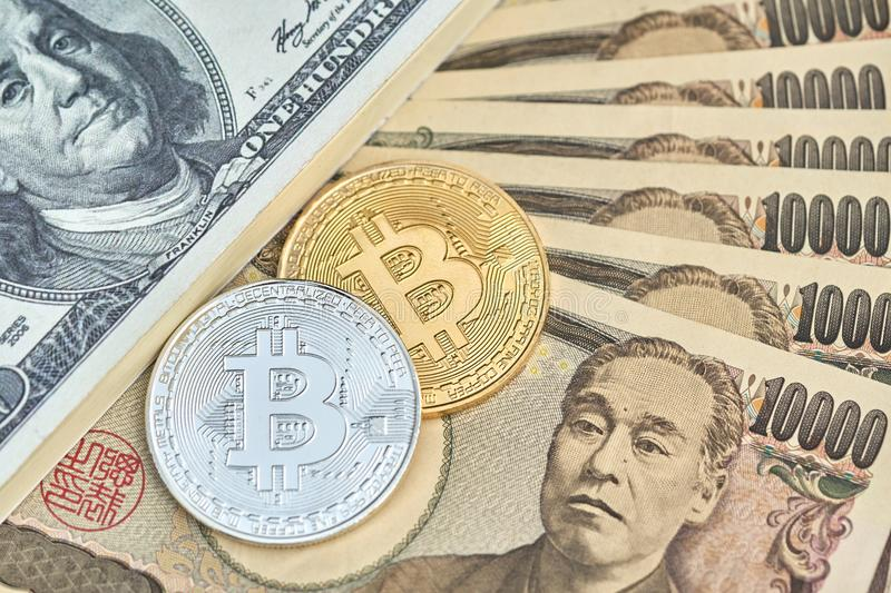 The digital currency Bit coin is made of silver and gold. Place Japanese bank notes and American banknotes dollars. using as b royalty free stock photography