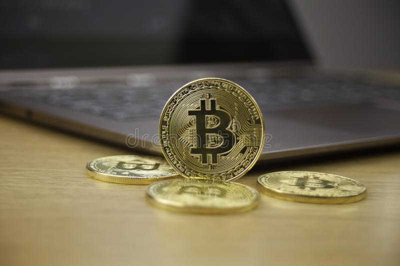 Digital currency physical gold metal coin. Cryptocurrency concept. stock image