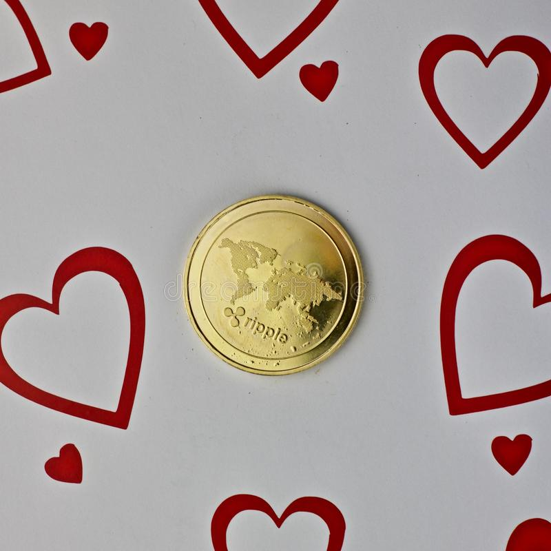 Ripple love coin. Digital currency physical metal ripple love coin. Valentines Day background royalty free stock image
