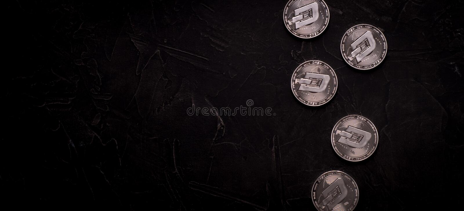 Digital currency physical metal silver dashcoin coin. stock image