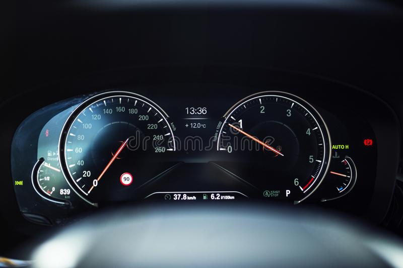 Car Interior: Digital Instrument Panel with Comfort Display. A Digital dashboard with digital instrument design. A digital TFT dial display with colourful stock images