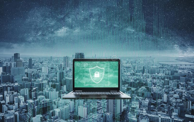 Digital data security system and protection on computer laptop. Computer laptop with shielding and safety system on screen. And futuristic background royalty free stock image
