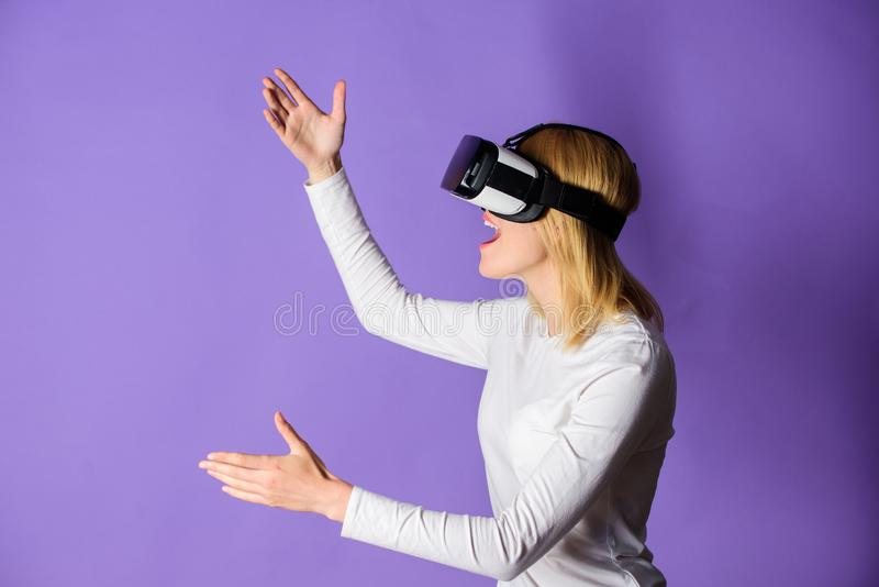 Digital device and modern opportunities. Woman head mounted display violet background. Virtual reality and future stock images