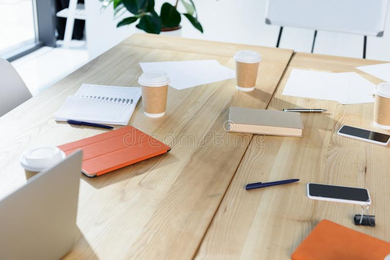 Digital devices and coffee to go on table. Selective focus of digital devices and coffee to go on table in office royalty free stock image
