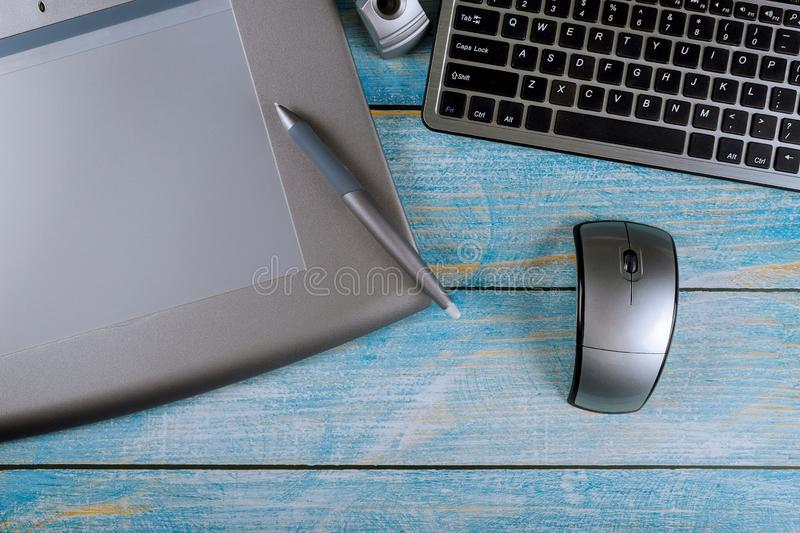 Digital devices on laptop and graphic tablet office table stock photography