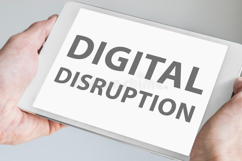 Digital disruption text displayed on touchscreen of modern tablet or smart device royalty free stock images