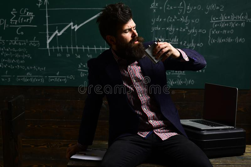 Digital education. Friendly teacher and adult smiling student in classroom. Teacher needs to have love for what he stock image