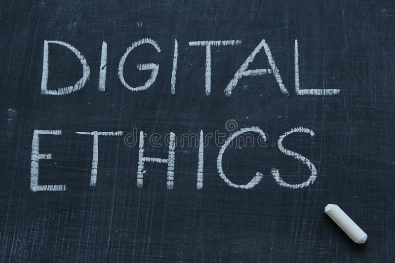 Digital Ethics. `Digital Ethics` handwritten in chalk on blackboard. Copy space royalty free stock photos