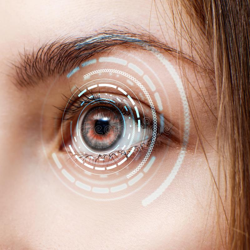 Digital female eye in process of scanning. New technologies and futuristic concept stock photos