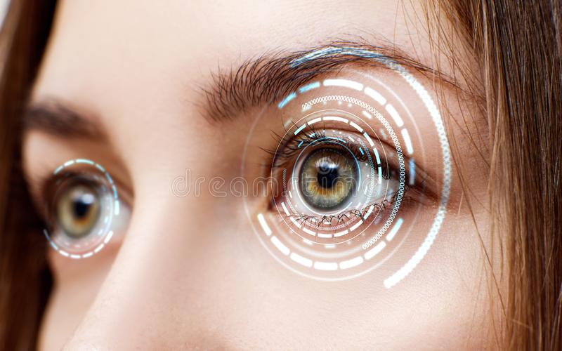 Digital female eye in process of scanning. New technologies and futuristic concept stock photography