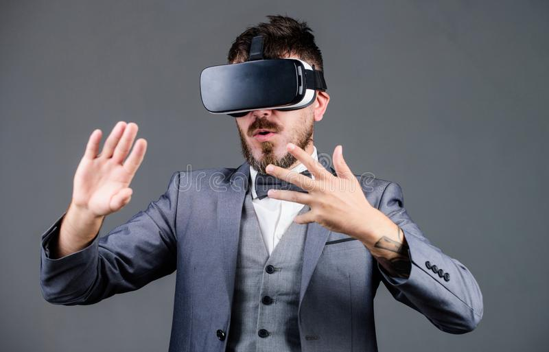 Digital future and innovation. bearded man wear wireless VR glasses. use future technology. businessman in VR headset. Visual reality. virtual reality goggles royalty free stock photos