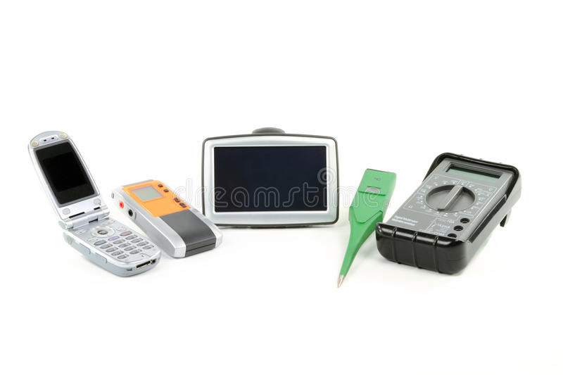 Digital gadgets. Still life picture of digital gadgets for everyday use - Cell Phone, Dictaphone, GPS, Thermometer, Multimeter, over white background stock images